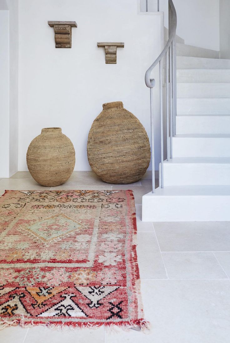 Moroccan Rugs make an inspired entryway A splash of colour in an otherwise neutral space.