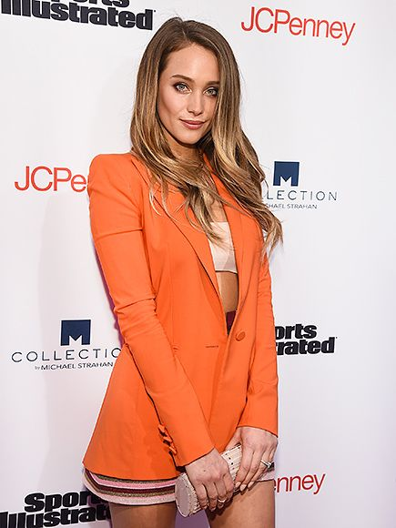 Star Tracks: Wednesday, April 13, 2016 |   ORANGE YOU BEAUTIFUL?   | Why yes, she is! Sports Illustrated Swimsuit Issue model Hannah Davis sports an orange ensemble at the magazine's Fashionable 50 event on Tuesday in N.Y.C.