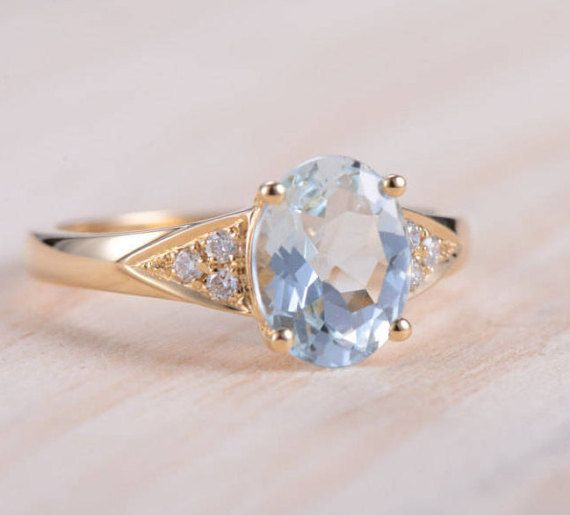 Aquamarine Engagement Ring Diamond Yellow Gold Oval Shape Anniversary Ring Promise Unique Ring Multistone Bridal Ring Antique Retro Ring  Product Introduction *Set in solid 14k Yellow Gold *Weight:2.76 g  Main stone** *Type:Aquamarine *Size:7*9mm *Color: Blue  Side Stone** *Type:Diamond *Weight:0.1 Carat *Color:White  *Size: US 4-11(including full, half and quarter sizes; Please confirm your size before ordering) *choose your ring size in the drop-down menu…