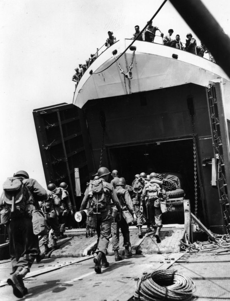 D-Day 1944: Members of a U.S. combat engineer unit march aboard a Landing Ship-Tank, or LST. - Found via Buzzfeed