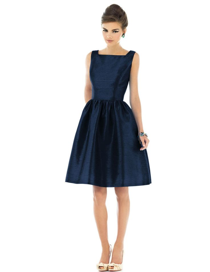 A classic cocktail dress  by Alfred Sung in dark sapphire.  A plus, this dress has pockets in case you need a place to store your bridesmaid speech!