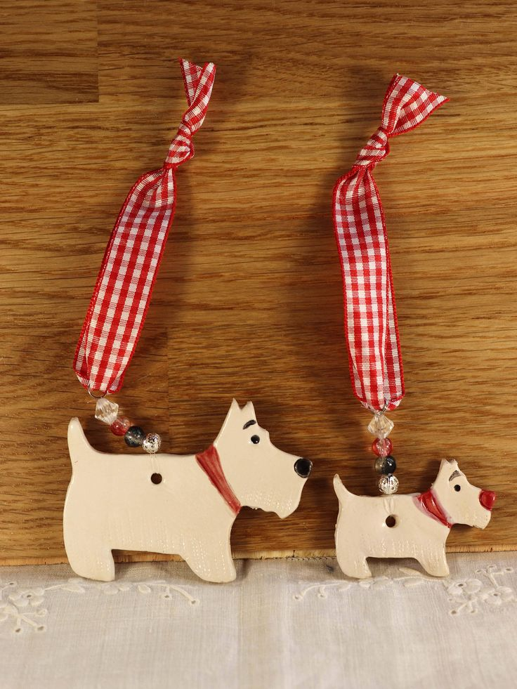 Excited to share the latest addition to my #etsy shop: Two lovely White Westie Terriers Dogs with red collars. Handmade Pottery sent to you in a lovely gossamer bag ready to be given as a gift. #housewares #homedecor #birthday #easter #whitewestiedogs #westhighlanddog #whiteterrierdog