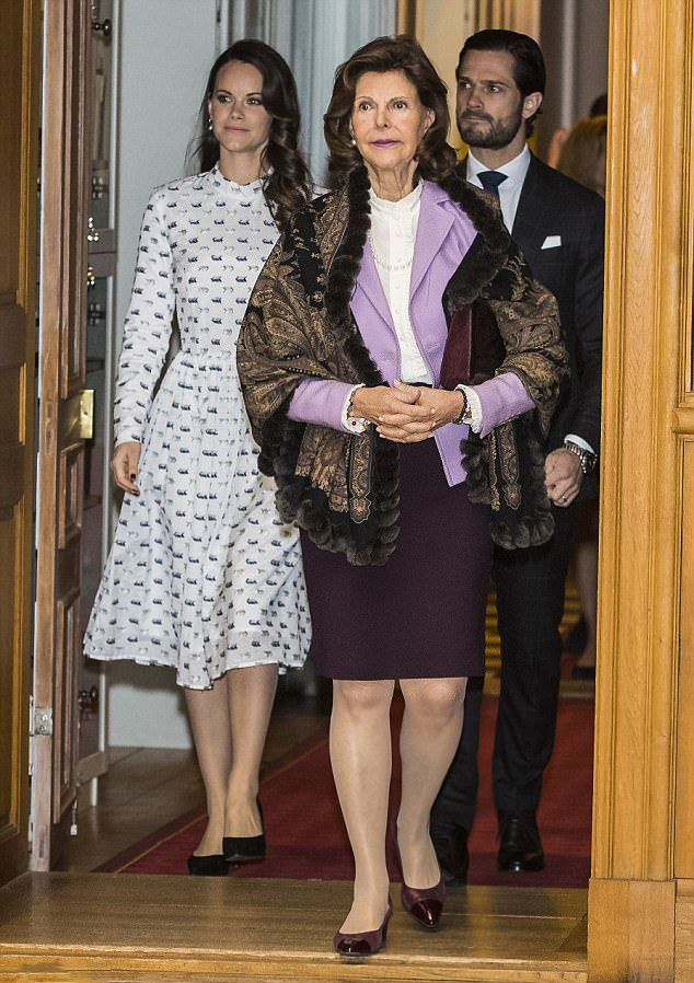 Sweden's Queen Silvia made an entrance, who looked regal in a white blouse and lavender-colored blazer, as she led her son Prince Carl Philip, who looked dapper in a check suit with a dark blue tie and pocket handkerchief and daughter-in-law Princess Sofia looked elegant in a pretty patterned dress, into the reception for their charity foundation at the Royal Palace in Stockholm.