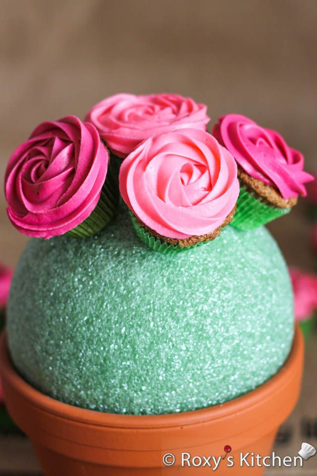 Rose Cupcake Bouquet in a Pot - Take a toothpick and insert it in the styrofoam ball where you want your cupcake. Take a cupcake and slide i...
