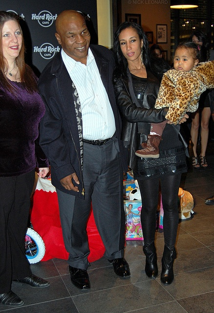 Mike Tyson with his current wife and new baby girl.