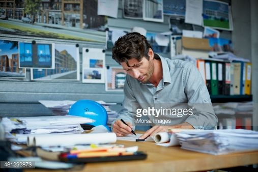 Stock Photo : Male architect working on project