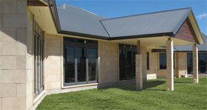 Timbercrete panels another cladding alternative. Ugly house tho
