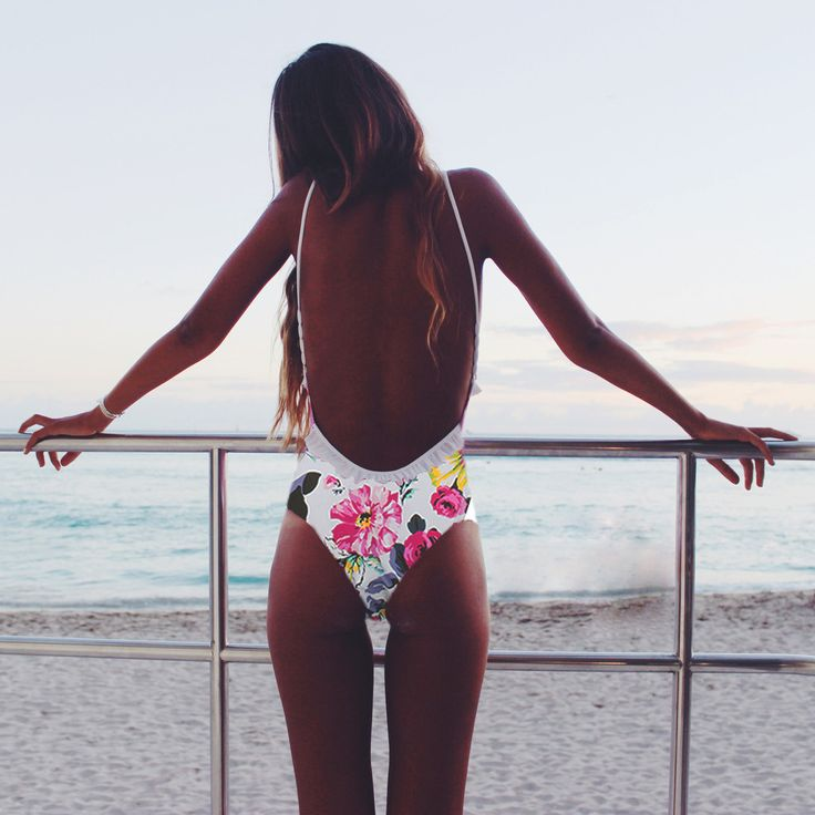 Flowers on your bum. | One piece swimsuit with low cut, open, back. Bright floral design. | via amoreandsorvete.com