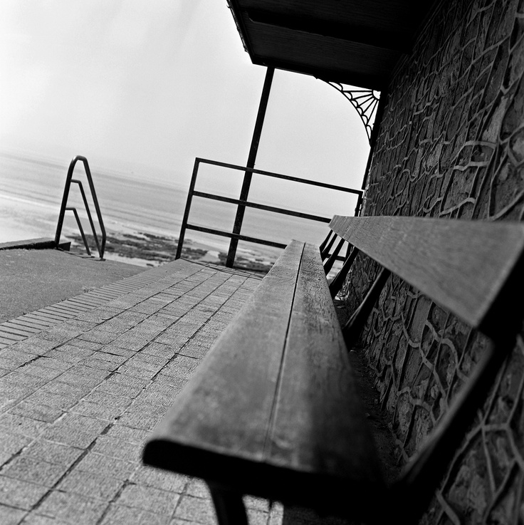 Bench by Keith Moss.  http://keithmoss.co.uk #bench #landscape #sea #keithmoss #film #ilford