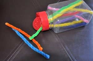 Air plane activity - fine motor - pipe cleaners and plastic bottle. A Parmesan cheese container would be perfect.