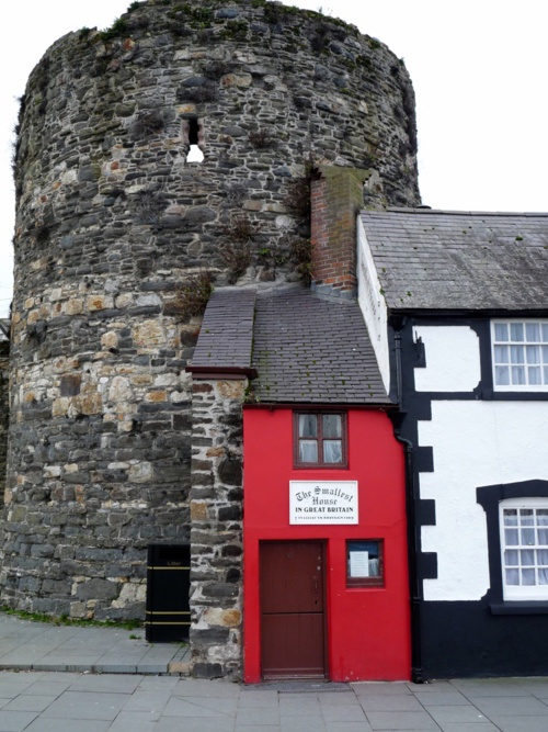 Smallest house in the UK is this one situated in Conwy, North Wales. If you visit Conwy be sure to read up a little about its history first. The castle there is quite amazing.