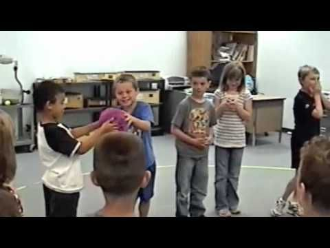 "Children pass the ball in this cooperative music game, and when they hear a ""new"" sound, the ball is passed in the opposite direction. This musical activity fosters cooperation in a fun, non-competitive way. You can request a free catalog of educational music and movement activities via email at SalemPerformingArts@msn.com"