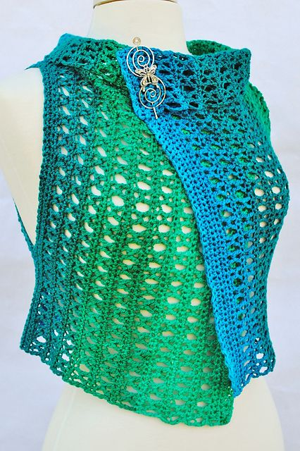 Ravelry: Tidal Shoals Hooked, crochet vest pattern by Michelle Stead. She shows several ways of draping/styling this simple shape too.
