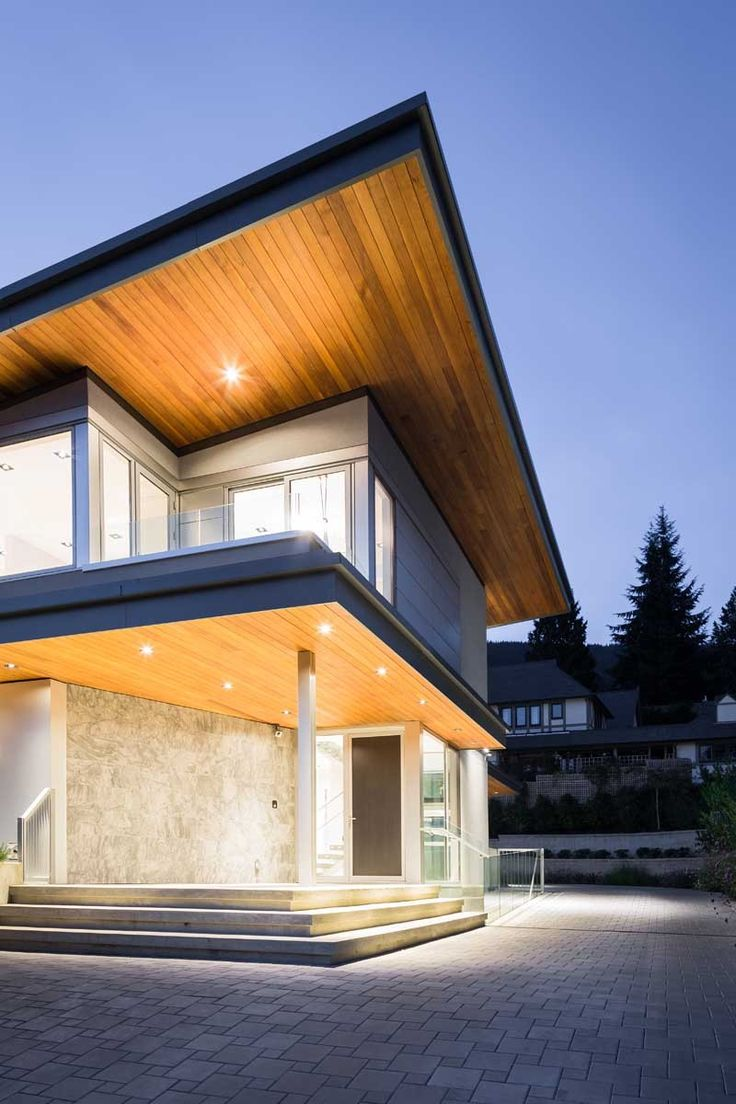 A Butterfly Roof And Dramatic Lighting Give This Home A Striking Appearance