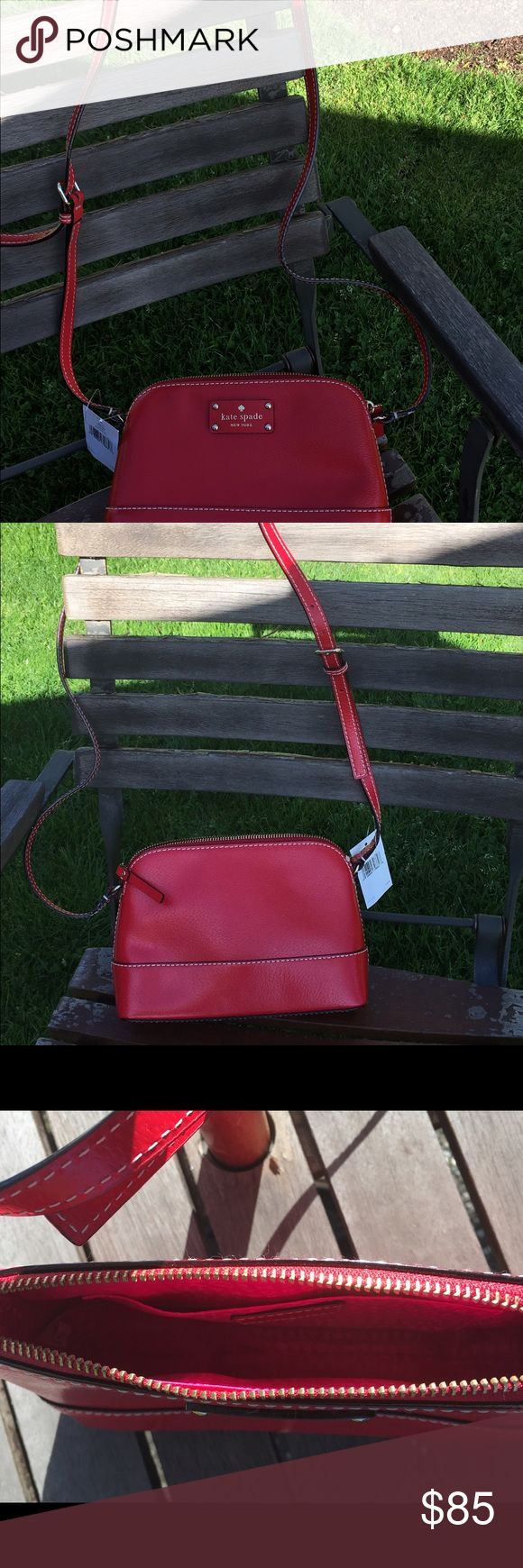 """Kate Spade Red shoulder bag Kate Spade red shoulder bag with tags. Measures 9"""" wide and 6 1/2"""" height exterior.  The interior soft opening measures 7 1/2"""" and 2 1/2"""" opening. Interior has magenta liner with one pocket. kate spade Bags Crossbody Bags"""