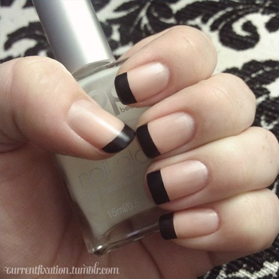 Simple matte black french manicure.
