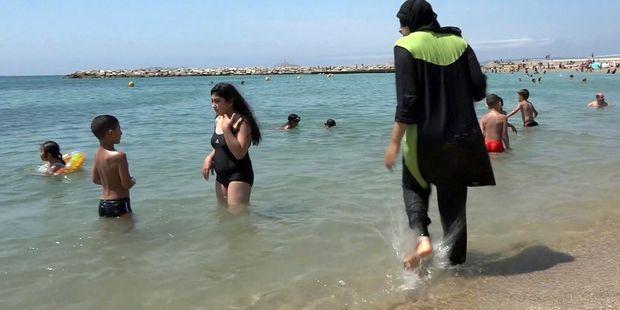Mass brawl after tourist takes photo of woman in burkini