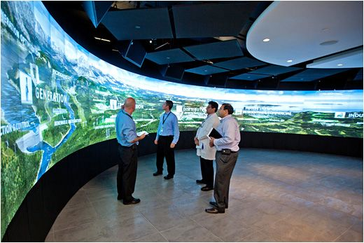 Advanced utilized Prysm's video wall technology along with several wall-mounted touchscreens to enable customers to explore GE's energy technologies firsthand and provide them with ways to discover solutions to improve and enhance their energy grids. In fact, it's the world's largest curved Prysm video wall, measuring 58 feet wide by 7 feet tall using 175 individual tiles with the thinnest seams currently possible.