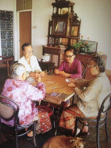 "Peranakan Nonyas playing a card game called ""Cerki just like my Grandma use to."