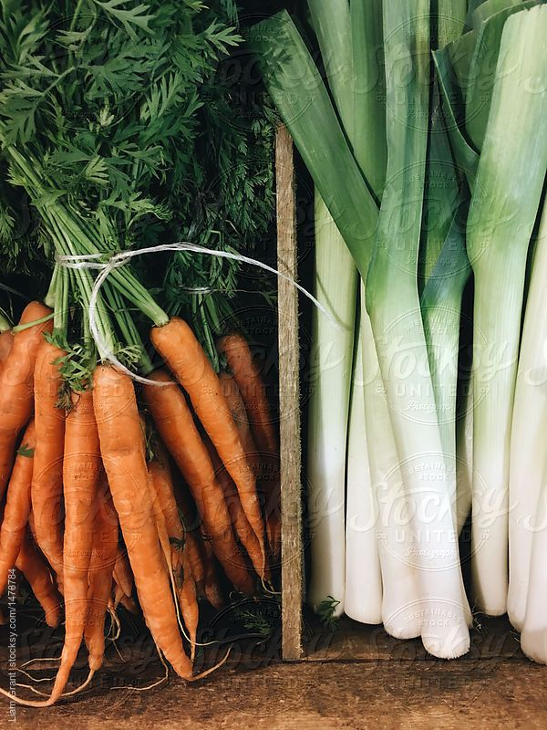 Carrots and Leeks by Liam Grant   Stocksy United