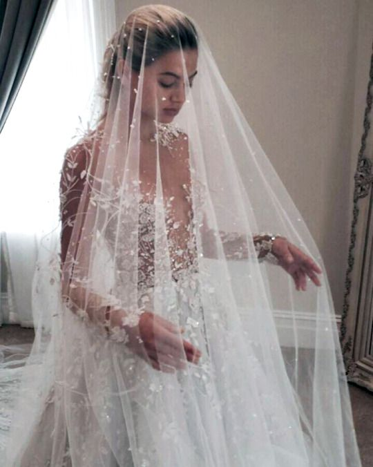 Love the details and accents on this long sleeve, seemingly see through dress. Love love love