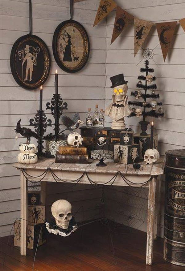 vintage halloween decorations wall pictures wooden table black chandlesticks skulls wall banner