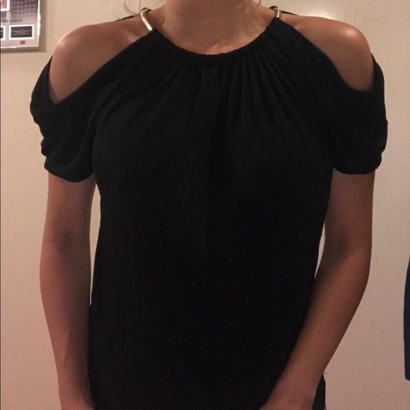 I just discovered this while shopping on Poshmark: Guess by Marciano black gold necklace top. Check it out!  Size: S, listed by reb33