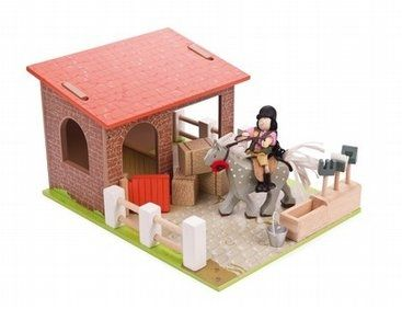 Stables With Horse Set from Le Toy Van.   The Budkins Stables is a comprehensive play set including a stable with a horse, an opening stable door, a tool station with tools, hay bales and removable fences. Complete with a painted wooden baseboard and Polly the riding girl Budkin character - all included!