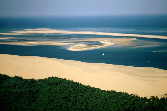 At 60 km (37 mi) from Bordeaux, in the South of the Arcachon Bay, it is possible to visit the highest dune in Europe, the Great Dune of Pyla (or Pilat). This dune reaches a height of 107m. At this summit, the view is spectacular with the ocean coast, the inlet of the Bay, the large pine forest and, when the sky is very clear, the Pyrenees Range.