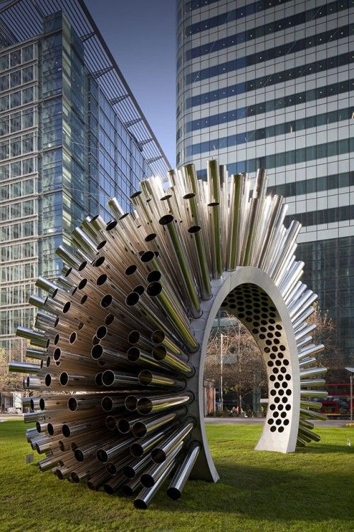 A Metal Sculpture That Plays The Breeze. by: artist Luke Jerram...: Metals Sculpture, Luke Jerram, The Artists, Canary Wharf, Arches, Amazing Sculpture, Plays, Greek God, Artists Luke