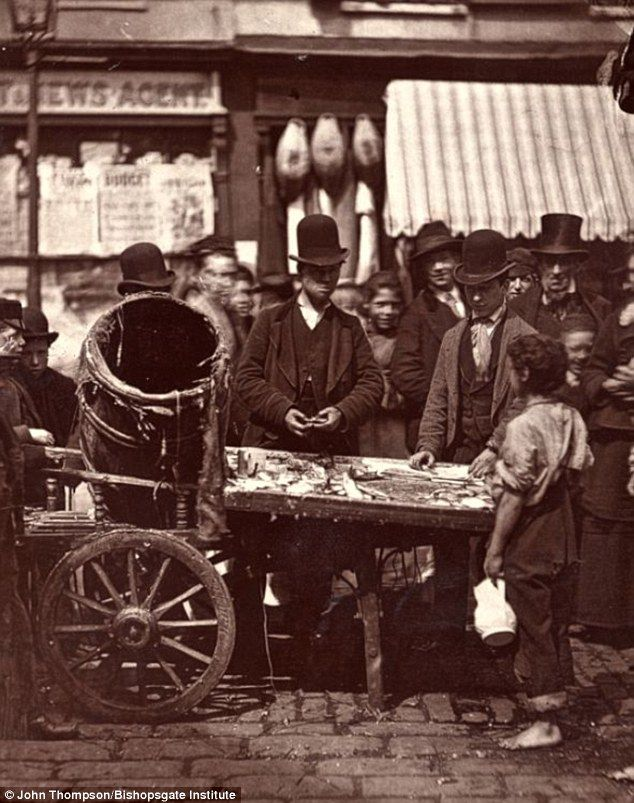 Social trading: Before ebay, small businesses frequently moved door to door, establishing their credibility through the advocacy of their customers much like ebay does today. This photo is from Bishopsgate Institute and shows a street fishmonger whose business was along Whitechapel road in London. Taken in 1876 by photographer John Thompson.
