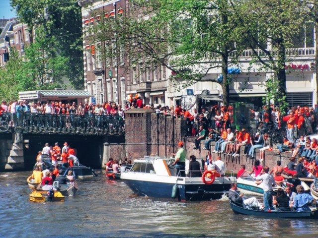 On 27th of April Dutch people celebrate Koningsdag (King's Day). Everyone puts on an orange t-shirt and they start the party on the streets and even on the canals of Amsterdam. There is a total madness ont he streets! The vrijmarkt (street market) where people sell second hand goods, the local foods, the music, the boats, the nightlife!