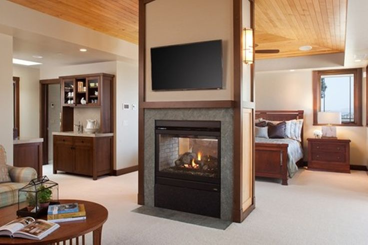 Sophisticated, contemporary double sided fireplace in the master bedroom. From 1 of 6 projects by Dawson Design Group, discovered on porch.com