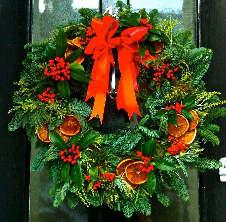 christmas wreath. dried oranges, red berries. #whitespacesdesign http://www.whitespacesdesign.com