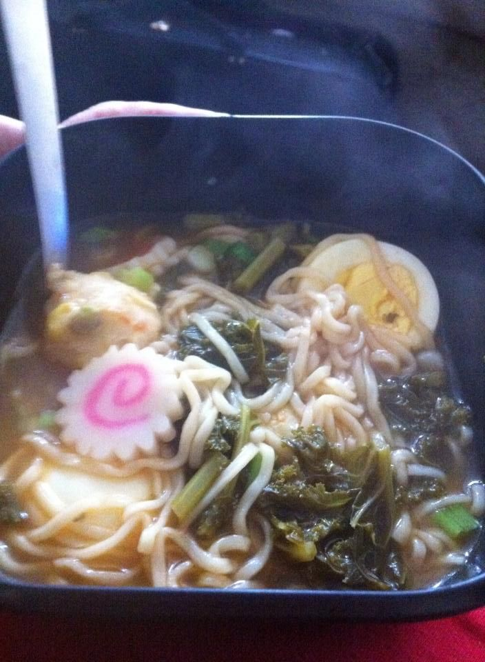 Ramen with all the fixings - boiled egg, shrimp balls, naruto (the white and pink swirl), green onions, and kale substituted for seaweed.