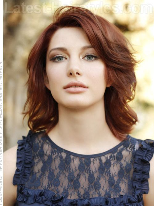 This gorgeous reddish brown color is the perfect shade to try out this summer. Rich, bold, and full of swirling dimension, this haircut falls right at the shoulders and is given a fantastic full shape with short to medium layers
