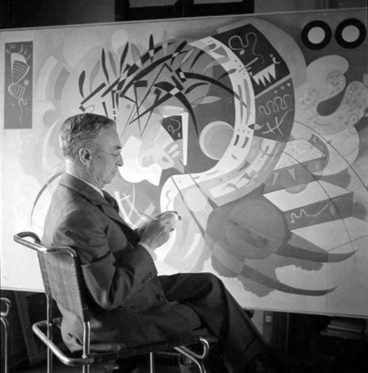 Wassily Kandinsky sitting in front of Dominant Curve painting 1936 Guggenheim Museum New York.