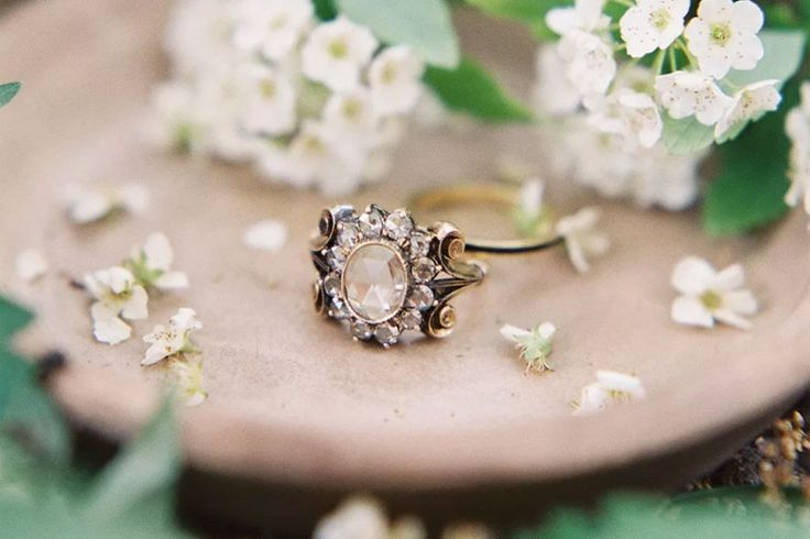 They have lived and been loved; they are uniquely romantic, and offer an original story that is one of a kind. Yes, we're talking about antique engagement rings! We love the intangible charm and history of these pieces, carrying generations of romance and blessings. You will not be wearing a uniform like most diamond rings …