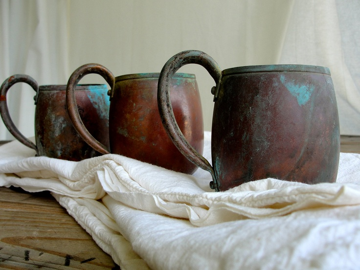 Before elbow grease...these shine up so fine...USA made West Bend, WI vintage 100% copper mugs for those Moscow Mules!