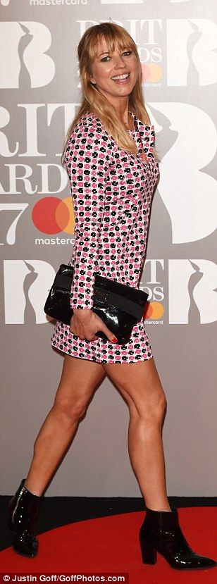 Laid back look: Sara Cox kept things simple in a patterned frock and patent black leather ...