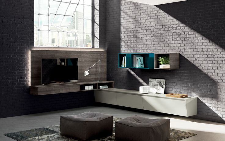 Corner living room solution affording the utmost freedom of composition, both in the units used as well as in the interesting combination of different colours and finishes (Turquoise gloss lacquered, Humus Oak decorative melamine and Ivory gloss lacquered).