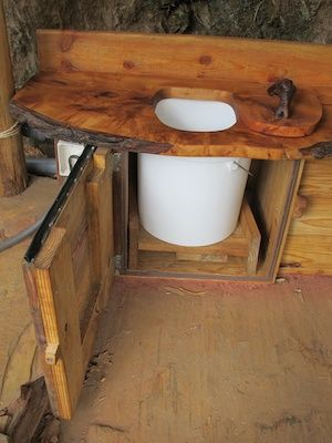 During construction - the composting toilet. A Joe Jenkins (The Humanure Handbook) style toilet - just a bucket, with a bin full of cover material (sawdust) built in. The wooden slab that forms the seat is lime.