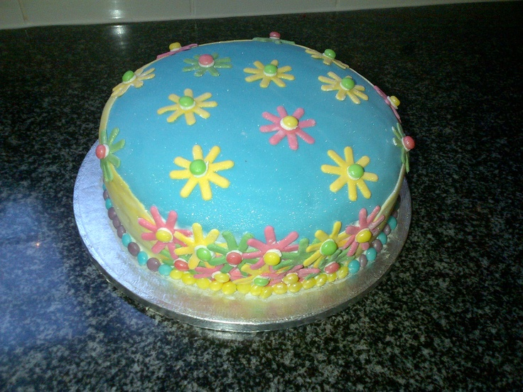 I baked this cake this morning for my brothers bake sale at school.... Its a red velvet and buttercream frosting cake...... I decorated it in colorful fondant.... Red velvet suits the wintery rainy weather and the decorations were inspired by my excitement for spring, which is around the corner