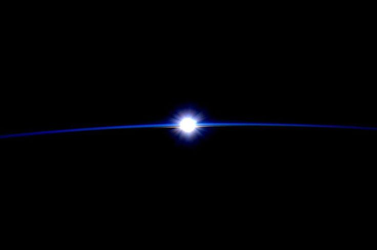 """From NASA: Astronaut Scott Kelly posted this striking photograph of the Sun peeking over the thin blue line of Earth's atmosphere to Twitter on September 21, 2015. Since the early days of space flight, astronauts have been drawn to the unique view of the atmosphere available from orbit. """"For the first time in my life, I saw the horizon as a curved line. It was accentuated by a thin seam of dark blue light: the atmosphere,"""" said Ulf Merbold, a German astronaut..."""