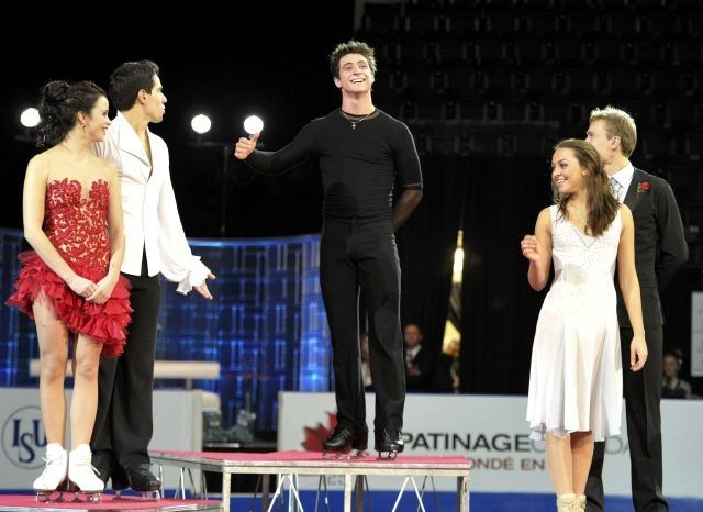 Tessa was sick and had to leave before the medal ceremony so Scott tried to make up for her absence.