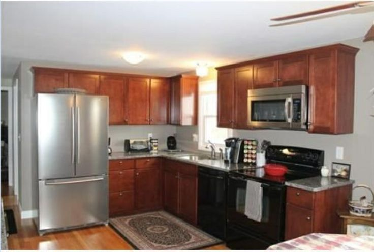 Cherry cabinets and stainless appliances kitchen pinterest for Cherry kitchen cabinets with white appliances
