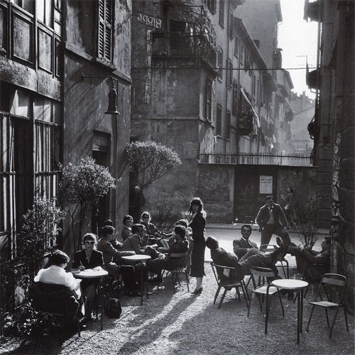 Reminds me of prints I've seen of late fifties early sixties Italian cafes. The furniture is very plain and doesn't look like the space would be very relaxing