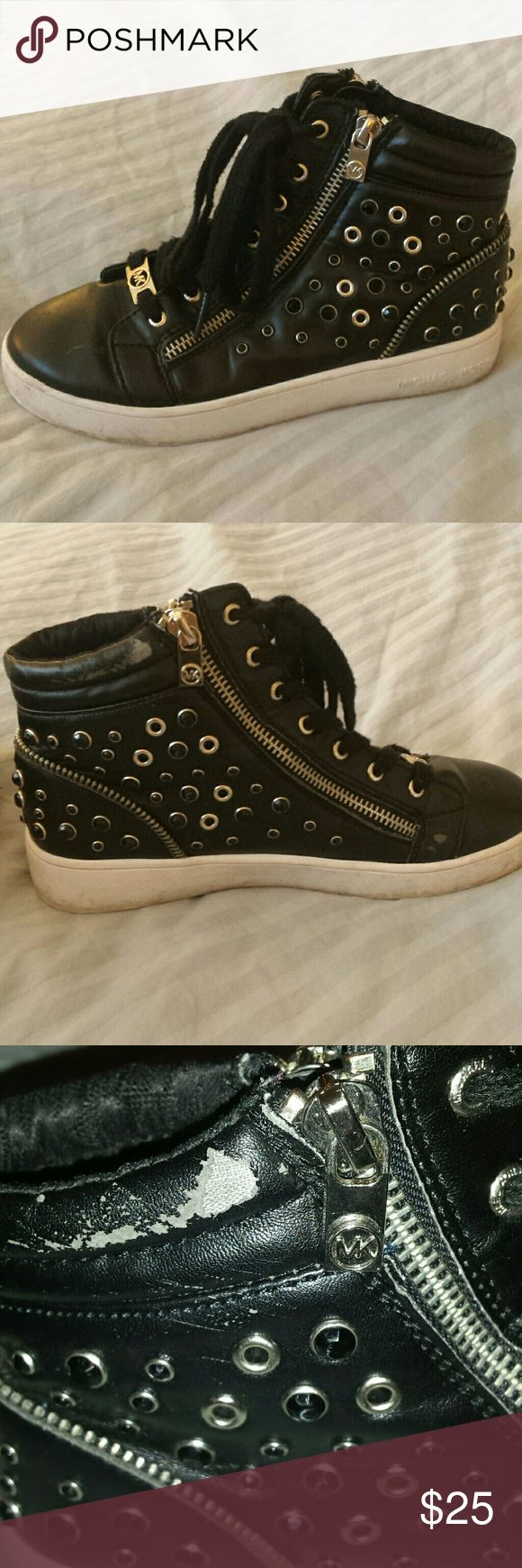 Michael Kors Girls high top sneakers Michael Kors Girls high top sneakers with zippers and rhinestones.  Some peeling on the inside fabric.  All man made materials.  Looks very nice on. Still have a lot of life left in them. Michael Kors Shoes Sneakers