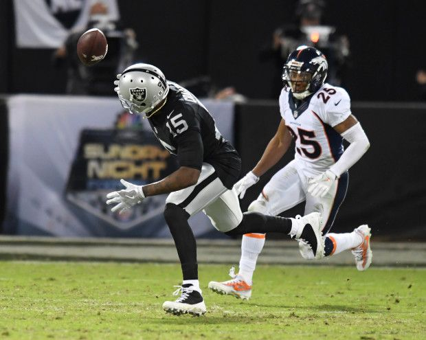 Broncos vs. Raiders:   November 6, 2016  -  30-20, Raiders  -    Oakland Raiders wide receiver Michael Crabtree (15) makes a juggling catch in front of Denver Broncos cornerback Chris Harris (25) during the fourth quarter of an NFL game at Oakland-Alameda County Coliseum on Nov. 6, 2016, in Oakland, Calif.