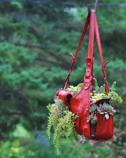 Old purse = hanging basket for flowers or herbs